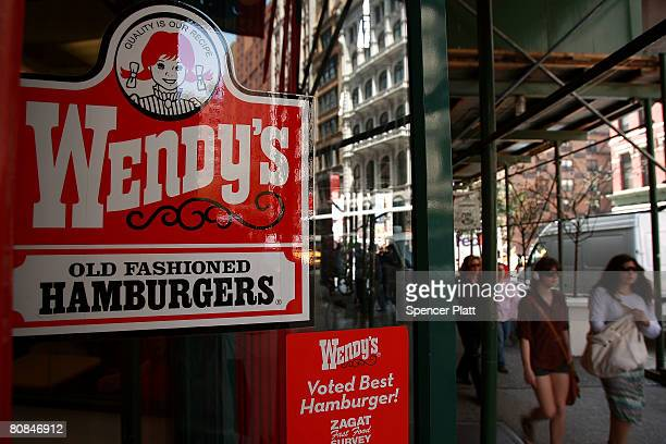 Pedestrians walk by a Wendy's hamburger chain April 24 2008 in New York City Wendy's International Inc which is the nation's No 3 hamburger chain was...