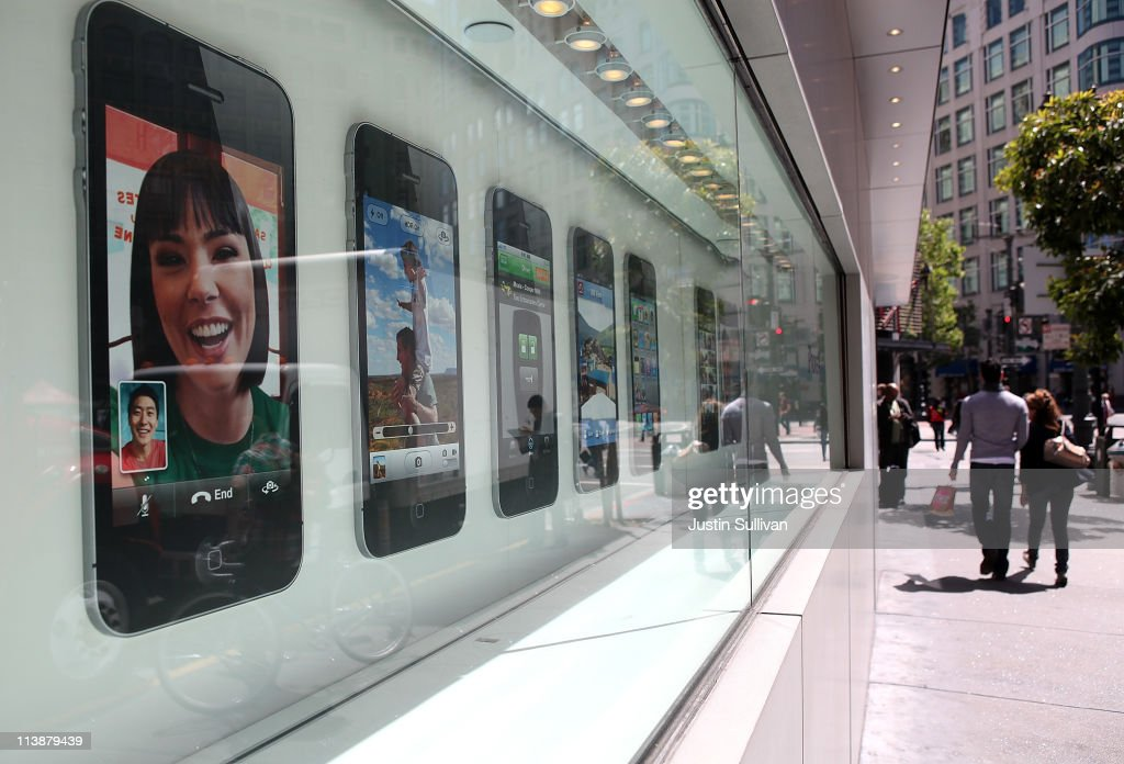 Pedestrians walk by a window display featuring the iPhone 4 at an Apple Store following an announcement that Apple has become the world's most valuable brand on May 9, 2011 in San Francisco, California. In a report released by London based Millward Brown, Apple Inc. has surpassed Google to claim the top spot in a global ranking of brand value this year with an estimated value of more than $153 billion up 84 percent from last year.