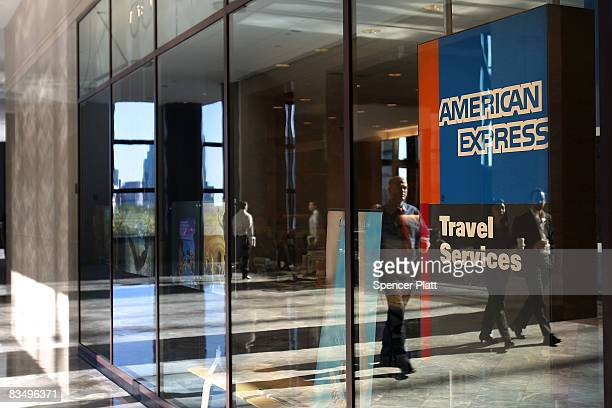 Pedestrians walk by an American Express travel agency inside the American Express headquarters October 30 2008 in New York City American Express a...