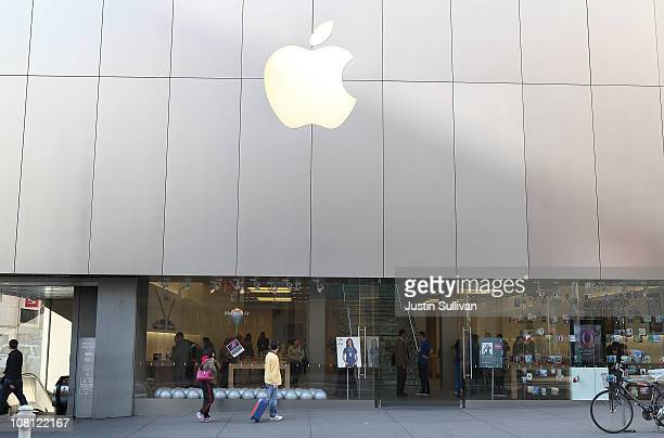 Pedestrians walk by an Apple retail store on January 18 2011 in San Francisco California Apple will release first quarter earnings one day after CEO...