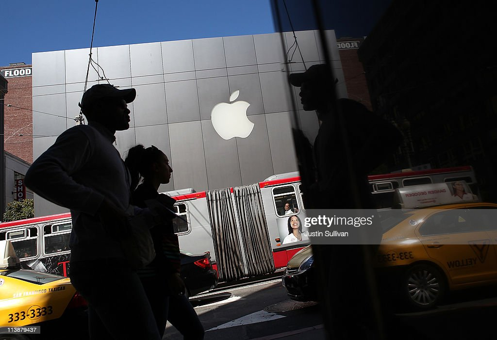 Pedestrians walk by an Apple Store following an announcement that Apple has become the world's most valuable brand on May 9, 2011 in San Francisco, California. In a report released by London based Millward Brown, Apple Inc. has surpassed Google to claim the top spot in a global ranking of brand value this year with an estimated value of more than $153 billion up 84 percent from last year.