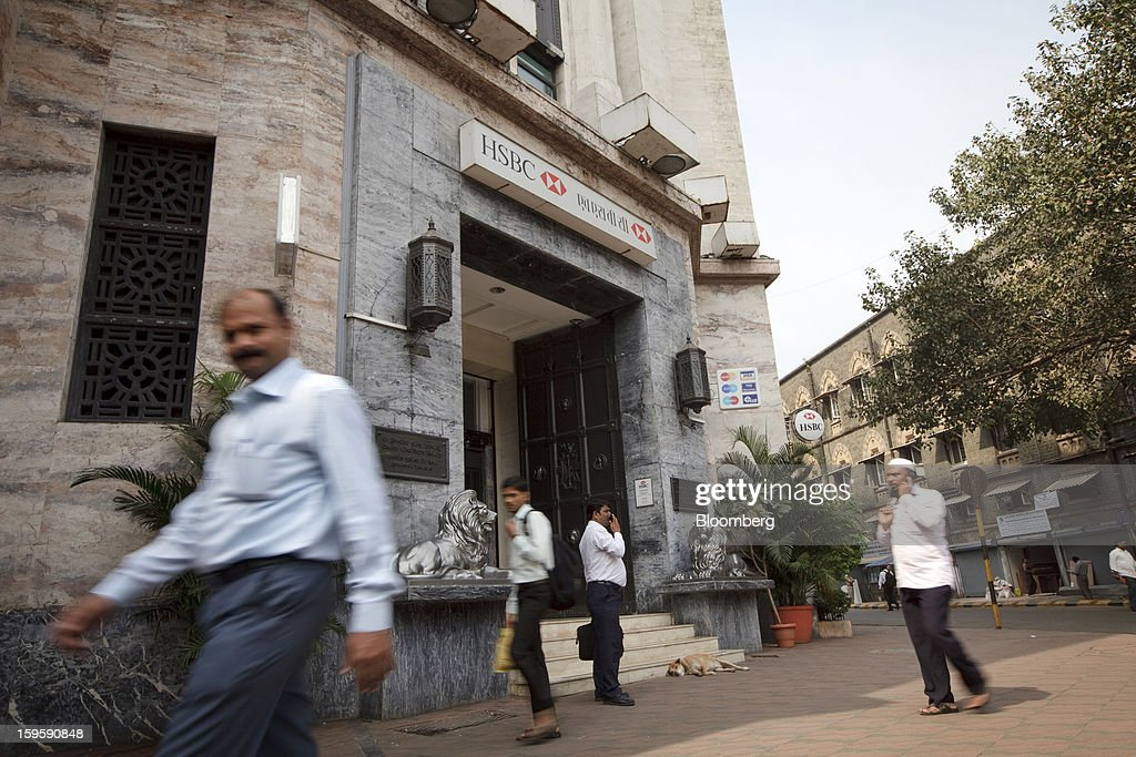 Pedestrians walk by an HSBC Holdings Plc bank branch in Mumbai, India, on Wednesday, Jan. 16, 2013. India's financial system has been made vulnerable by a deterioration in bank assets and a lack of capital as the economy slowed, according to the International Monetary Fund. Photographer: Kuni Takahashi/Bloomberg via Getty Images