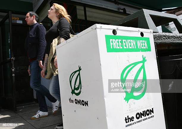 Pedestrians walk by an Onion news rack May 5 2009 in San Francisco California Satirical newspaper the Onion is ceasing publication in Los Angeles and...