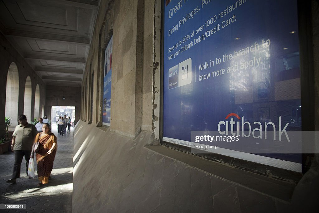 Pedestrians walk by Citigroup Inc. advertisements in Mumbai, India, on Wednesday, Jan. 16, 2013. India's financial system has been made vulnerable by a deterioration in bank assets and a lack of capital as the economy slowed, according to the International Monetary Fund. Photographer: Kuni Takahashi/Bloomberg via Getty Images