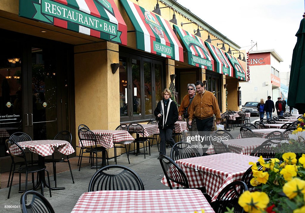 Pedestrians walk by empty tables at Cioppino's Seafood Restaurant December 3, 2008 in San Francisco, California. A report by The Institute for Supply Management says that its services sector index dropped in November to 37.3, down from 44.4 in October as the service industry struggles through the weak economy.