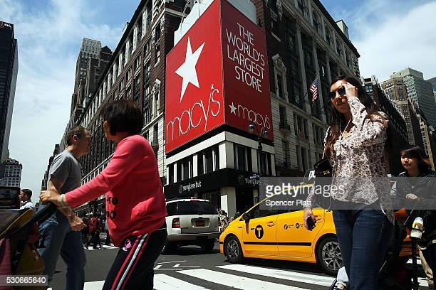 Pedestrians walk by Macy's flagship store in Herald Square on May 11 2016 in New York New York As the retailer faces a second year of sales declines...