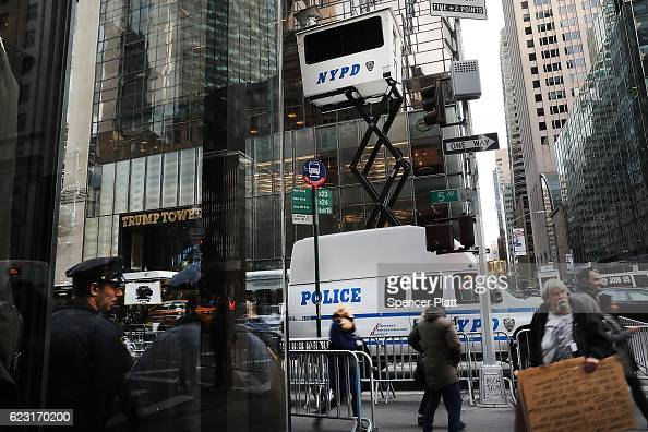 Pedestrians walk by new police security posts outside of Trump Tower that have been installed since Donald Trump became the presidentelect on...