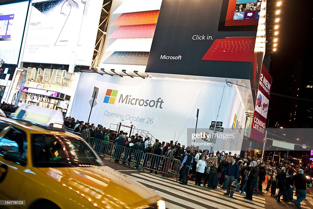 Pedestrians walk by the covered Microsoft Corp. store prior to the store's grand opening in New York, U.S., on Thursday, Oct. 25, 2012. Microsoft Corp. introduced the biggest overhaul of its flagship Windows software in two decades, reflecting the rising stakes in its competition with Apple Inc. and Google Inc. for the loyalty of customers who are shunning personal computers and flocking to mobile devices. Photographer: Ramin Talaie/Bloomberg via Getty Images