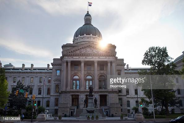 Pedestrians walk by the Indiana State House in Indianapolis Indiana US on Sunday May 20 2012 The Indiana agency that supervised February's Super Bowl...