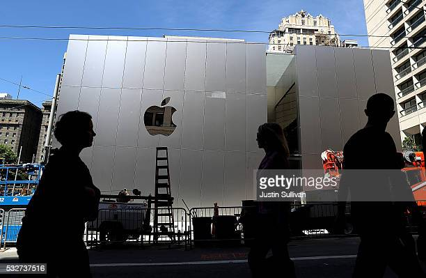 Pedestrians walk by the new flagship Apple Store on May 19 2016 in San Francisco California Apple is preparing to open its newest flagship store in...