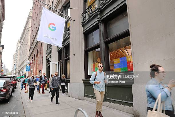 Pedestrians walk by the new Google popup shop in the SoHo neighborhood on October 20 2016 in New York City The shop lets people try out new Google...