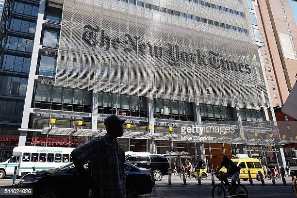 Pedestrians walk by the outside The New York Times building where photographer Bill Cunningham worked on June 30 2016 in New York City Cunningham...