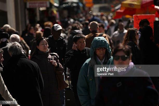 Pedestrians walk down a city street on March 25 2011 in New York City According to the 2010 census count released yesterday New York City's...