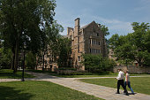 Pedestrians walk down a path on the Yale University campus in New Haven Connecticut US on Friday June 12 2015 Yale University is an educational...