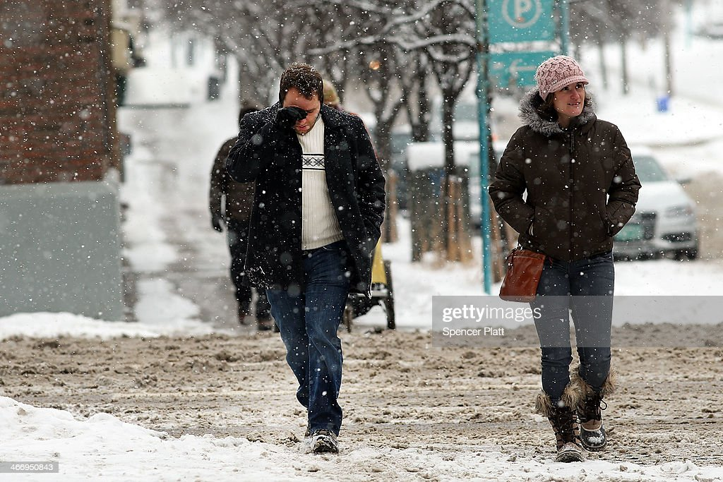 Pedestrians walk down a street in heavy snow on February 5, 2014 in Burlington, Vermont. Burlington, and much of the Northeast, received another mix of wintery weather on Wednesday causing traffic accidents and hundreds of flight cancelations.
