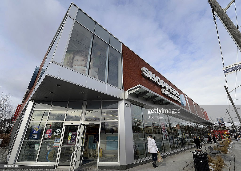 Pedestrians walk in front of a Shoppers Drug Mart Corp. store in Toronto, Ontario, Canada, on Monday, Feb. 4, 2013. Shoppers Drug Mart Corp., Canada's largest pharmacy chain, is scheduled to release earnings data on Feb. 7. Photographer: Aaron Harris/Bloomberg via Getty Images