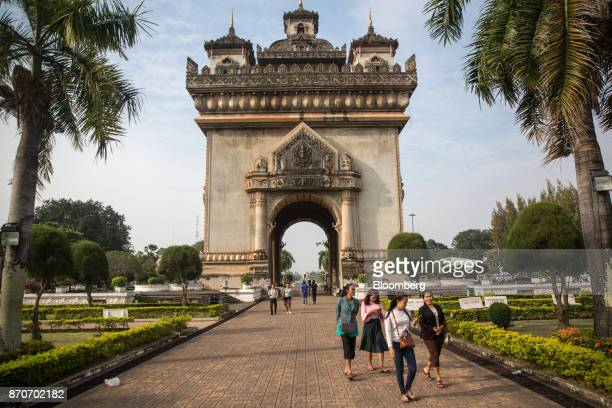 Pedestrians walk in front of the Patuxai Victory monument in Vientiane Laos on Thursday Nov 2 2017 Located in the Mekong region Southeast Asia's...