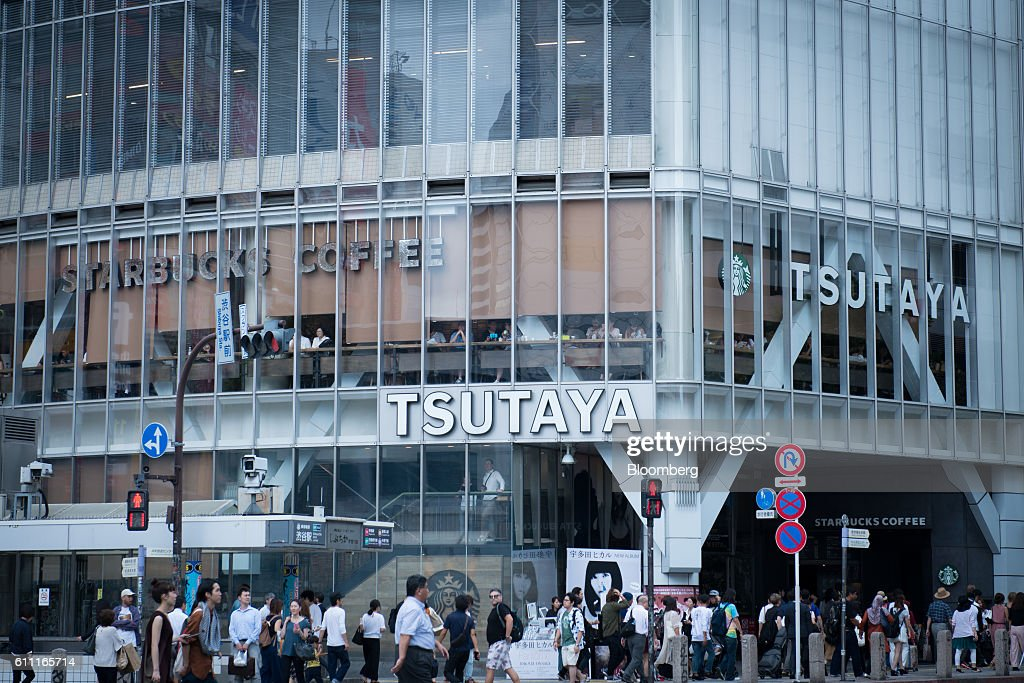 Pedestrians walk in front of the Shibuya Tsutaya media store in the Shibuya district of Tokyo, Japan, on Wednesday, Sept. 28, 2016. Spotify Ltd. is bringing its popular online music service to Japan, a large and lucrative market where fans have demonstrated a continuing fondness for CDs and even vinyl records. Photographer: Noriko Hayashi/Bloomberg via Getty Images