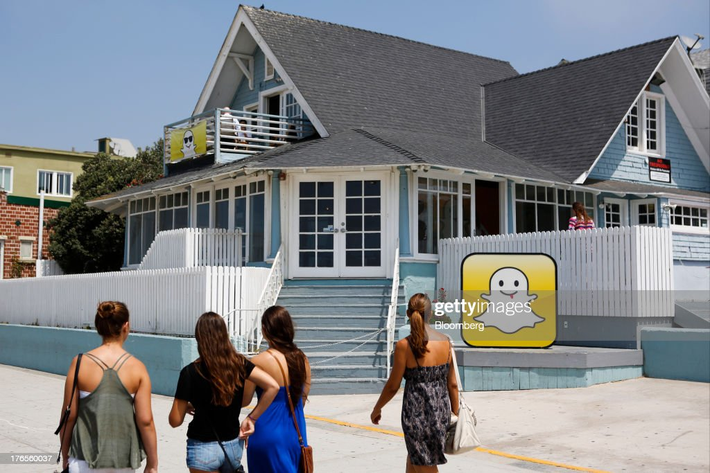 Pedestrians walk in front of the Snapchat Inc. headquarters on the strand at Venice Beach in Los Angeles, California, U.S., on Wednesday, Aug. 14, 2013. Snapchat is a photo and video sharing application that allows the user to pre-set a period of time, no more than ten seconds, for the receiver to view the content before it disappears from the screen. Photographer: Patrick Fallon/Bloomberg via Getty Images