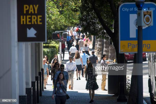 Pedestrians walk in the downtown area of Sacramento California US on Tuesday June 6 2017 As the cost of daily life tests the bounds of gravity in San...