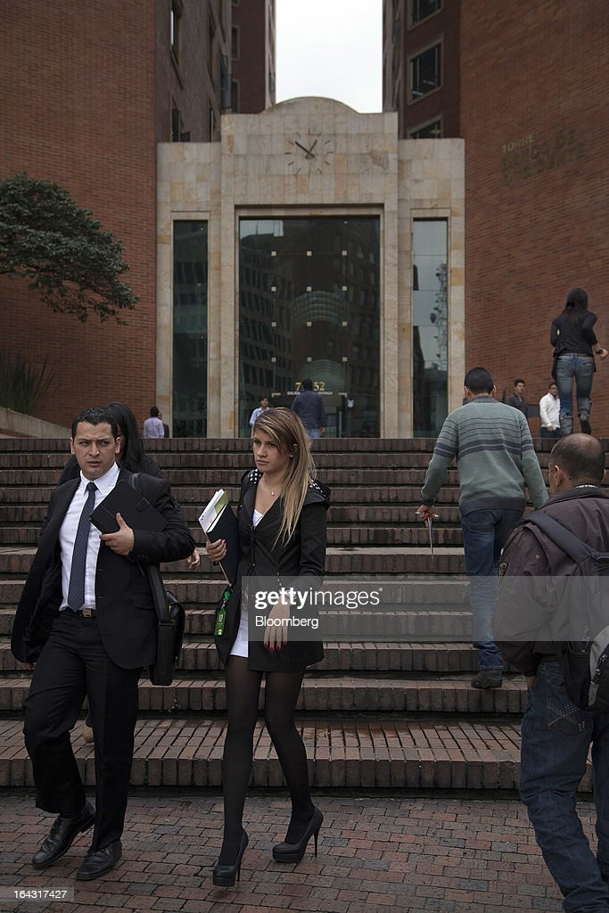 Pedestrians walk in the financial district of Bogota, Colombia, on Friday, March 22, 2013. Central bank policy makers will lower borrowing costs by 25 basis points to 3.5 percent on March 22, according to 29 of 32 analysts and economists surveyed by Bloomberg. Photographer: Jose Cendon/Bloomberg via Getty Images
