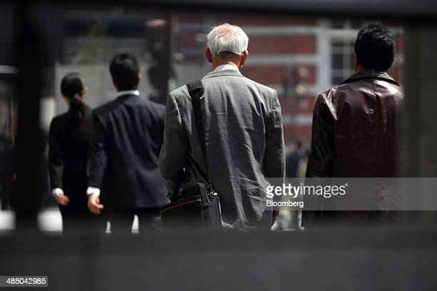 Pedestrians walk in Tokyo Japan on Wednesday April 16 2014 Japan's population slid for a third year with the proportion of people over the age of 65...