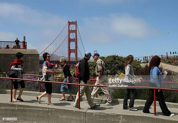 Pedestrians walk near the Golden Gate Bridge July 17 2008 in San Francisco California San Francisco was named the most 'walkable' city in the nation...