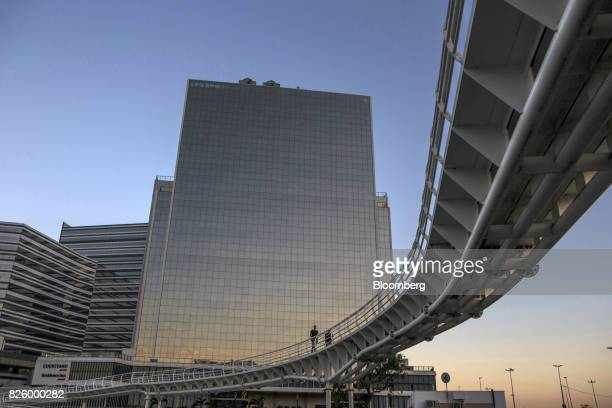 Pedestrians walk on a bridge connecting a Bus Rapid Transit station to the Olympic park in Rio de Janeiro Brazil Brazil on Wednesday Aug 2 2017...