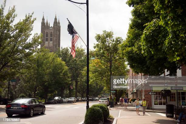 Pedestrians walk on Naussau Street across from the Princeton University campus in Princeton New Jersey US on Friday Aug 30 2013 Residents in...