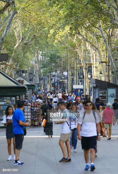 Pedestrians walk on the busy La Rambla street in Barcelona Spain on Aug 18 after a van ploughed through a crowd of pedestrians in the area the...
