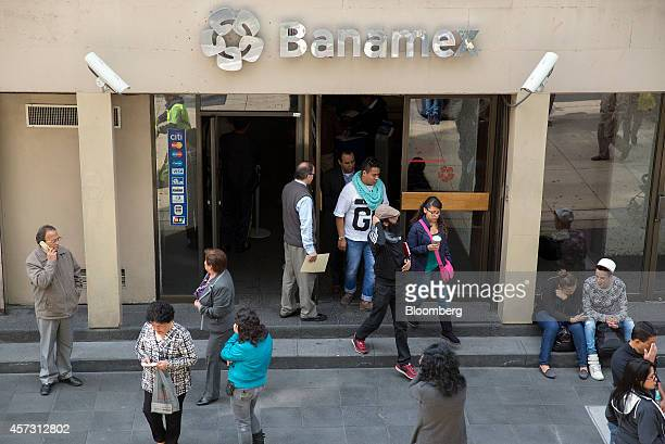 Pedestrians walk outside a Banamex branch in Mexico City Mexico on Wednesday Oct 15 2014 Citigroup Inc's Mexico unit Banamex was fined 30 million...