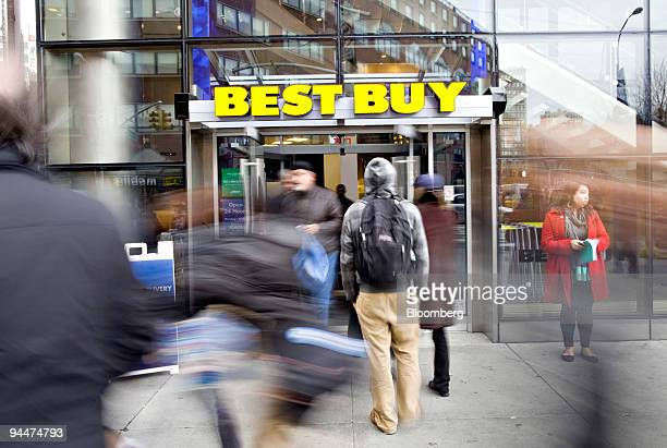 Pedestrians walk outside a Best Buy store in New York US on Tuesday Dec 15 2009 Best Buy Co the largest electronics retailer said its fourthquarter...
