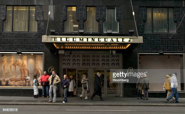 Pedestrians walk outside Bloomingdale's flagship store in New York on February 28 2005 Federated Department Stores Inc the owner of Macy's and...