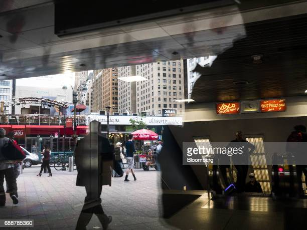 Pedestrians walk outside of Pennsylvania Station in New York US on Friday May 26 2017 President Donald Trump tapped New York developer Steven Roth as...