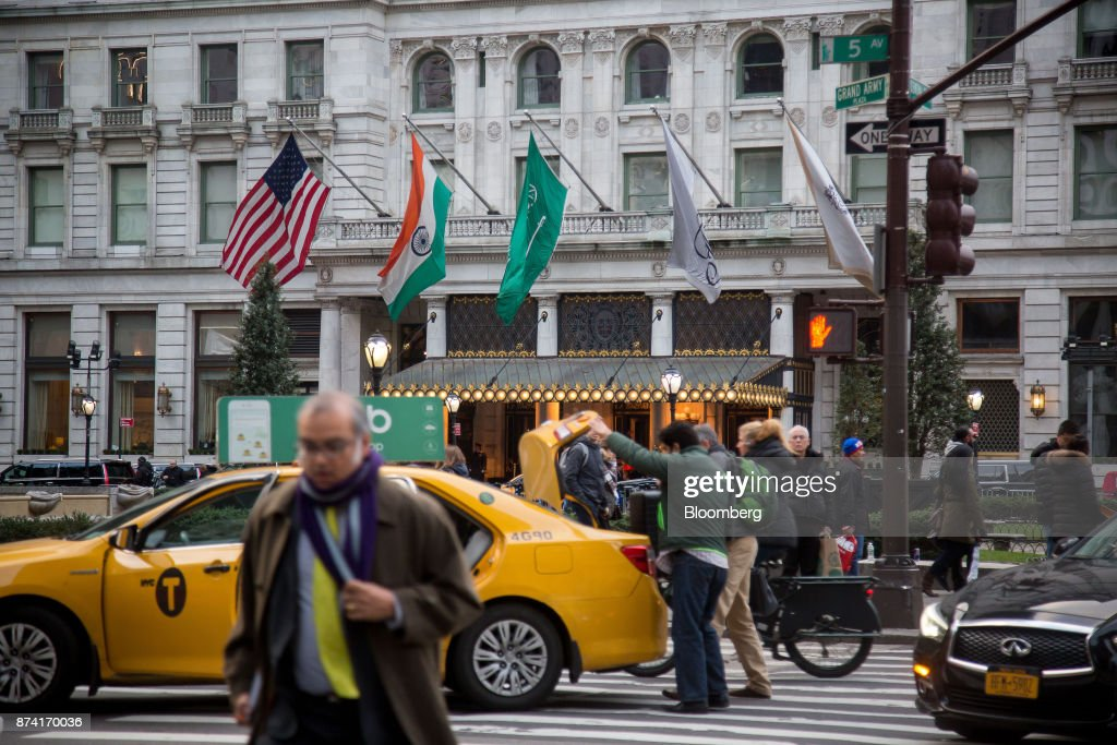 Pedestrians walk outside of the Plaza Hotel in New York, U.S., on Monday, Nov. 13, 2017. Billionaire Saudi Prince Alwaleed bin Talal has long been associated with New York's iconic Plaza Hotel, ever since he bought out Donald Trump over two decades ago. Photographer: Michael Nagle/Bloomberg via Getty Images