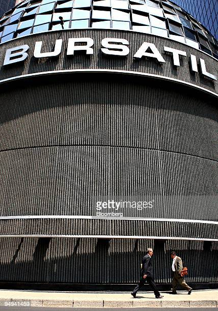 Pedestrians walk outside the building which houses the Mexican Stock Exchange or Bolsa Mexicana de Valores in Mexico City Mexico on Wednesday May 20...