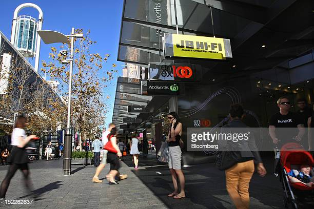 Pedestrians walk outside the Enex100 shopping center operated by Industry Superannuation Property Trust on the Hay Street mall in the central...