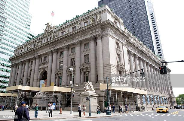 Pedestrians walk outside the US Customs House which houses the United States Bankruptcy Court for the Southern District of New York in New York US on...