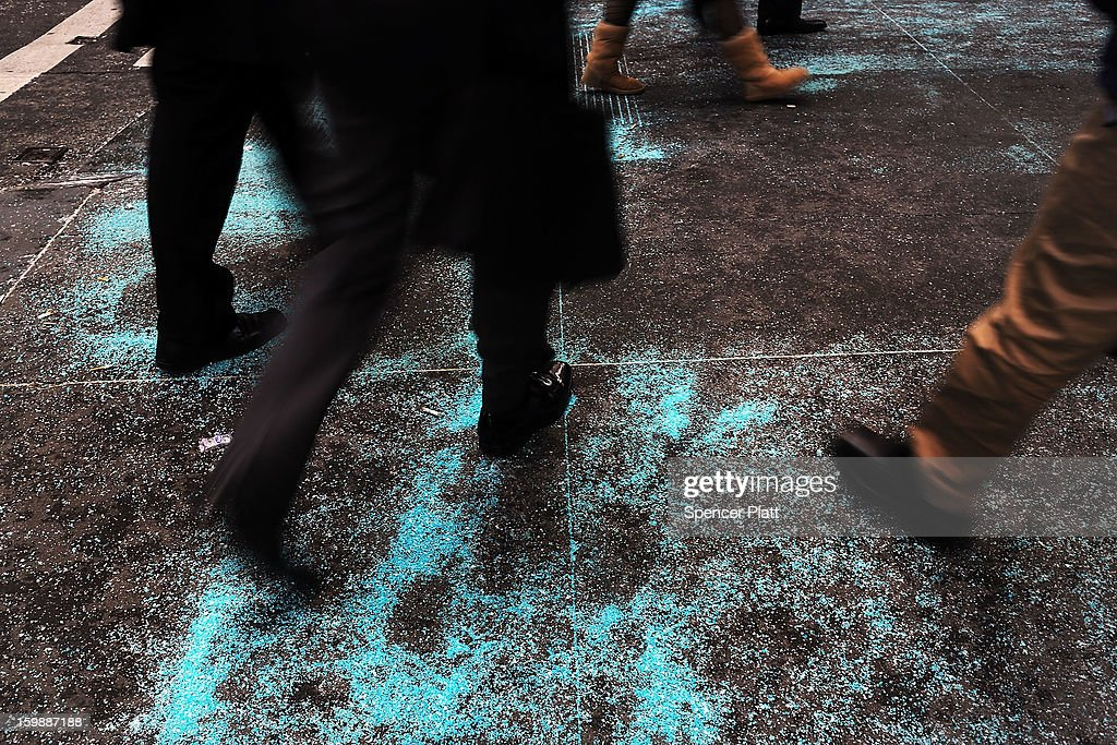 Pedestrians walk over blue salt on the sidewalk after a light snow fall on one of the coldest days of the year on January 22, 2013 in New York City. New York, and much of the Northeast, will be experiencing colder-than-usual temperatures for the remainder of the week with temperatures in the 20's and a wind chill feeling in the single digits.
