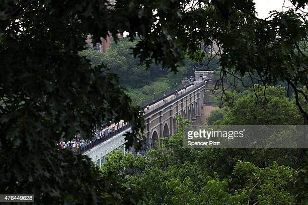 Pedestrians walk over the High Bridge the city's oldest standing bridge for the first time since it was closed in the early 1970s on June 9 2015 in...