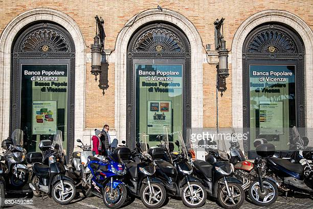 Pedestrians walk past a Banca Popolare di Vicenza SpA bank branch in Rome Italy on Friday Dec 23 2016 The nationalization of Banca Monte dei Paschi...