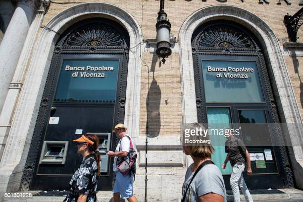 Pedestrians walk past a Banca Popolare di Vicenza SpA bank branch in Rome Italy on Monday June 26 2017 Italy orchestrated its biggest bank rescue on...