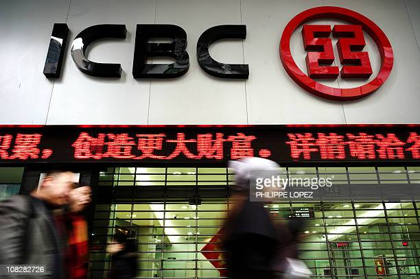 Pedestrians walk past a branch of China's banking giant Industrial and Commercial Bank of China in Shanghai on January 18 2011 According reports ICBC...