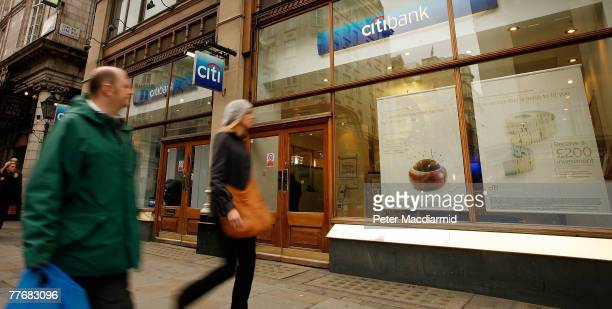 Pedestrians walk past a branch of Citibank on The Strand on November 5 2007 in central London England Chairman and chief executive of Citigroup...