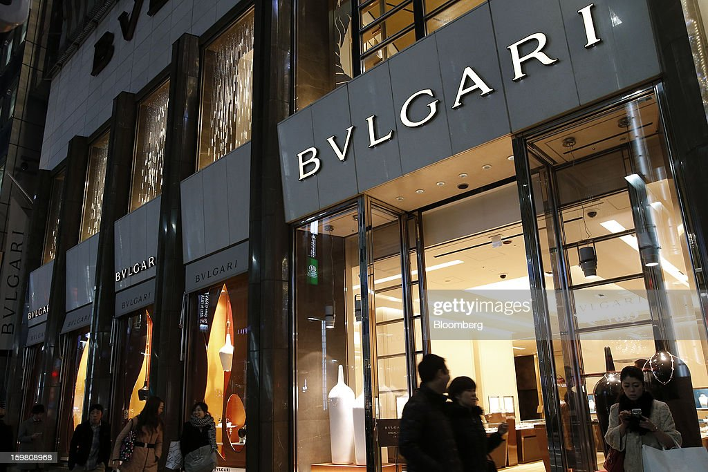 Pedestrians walk past a Bulgari SpA store, a luxury unit of LVMH Moet Hennessy Louis Vuitton SA, in the Ginza district of Tokyo, Japan, on Sunday, Jan. 20, 2013. Japan's consumer prices excluding fresh food, a benchmark monitored by the central bank, haven't advanced 2 percent for any year since 1997, when a national sales tax was increased. Photographer: Kiyoshi Ota/Bloomberg via Getty Images