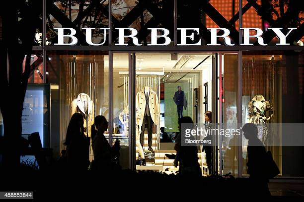 Pedestrians walk past a Burberry Group Plc store in the Omotesando district of Tokyo Japan on Thursday Nov 6 2014 The Bank of Japan's extra stimulus...