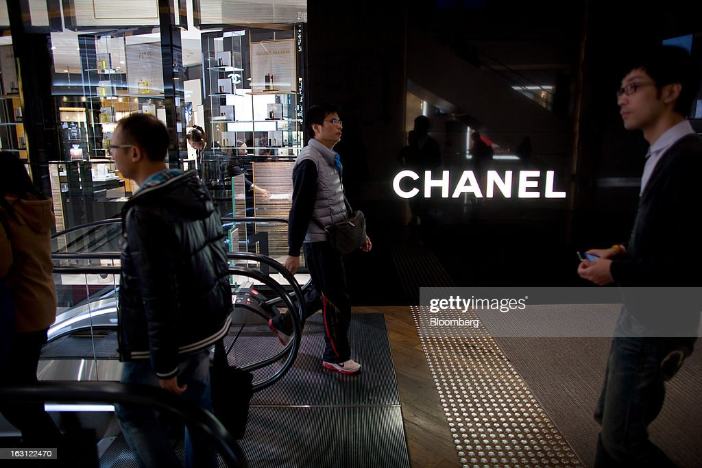Pedestrians walk past a Chanel SA store at Hysan Development Co.'s Hysan Place mall in the Causeway Bay district of Hong Kong, China, on Monday, March 4, 2013. Hysan is scheduled to release earnings on March 6. Photographer: Lam Yik Fei/Bloomberg via Getty Images