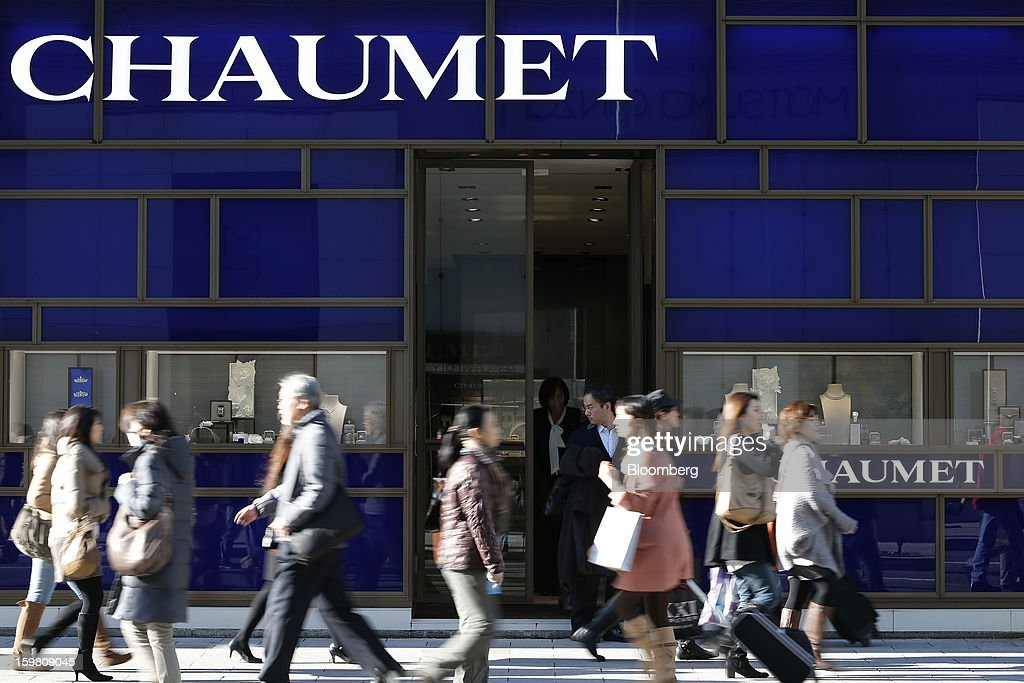 Pedestrians walk past a Chaumet store, a luxury unit of LVMH Moet Hennessy Louis Vuitton SA, in the Ginza district of Tokyo, Japan, on Sunday, Jan. 20, 2013. Japan's consumer prices excluding fresh food, a benchmark monitored by the central bank, haven't advanced 2 percent for any year since 1997, when a national sales tax was increased. Photographer: Kiyoshi Ota/Bloomberg via Getty Images