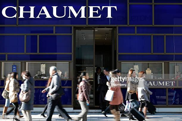 Pedestrians walk past a Chaumet store a luxury unit of LVMH Moet Hennessy Louis Vuitton SA in the Ginza district of Tokyo Japan on Sunday Jan 20 2013...