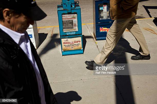 Pedestrians walk past a Chicago SunTimes newspaper box in downtown Chicago The newspaper's owner the SunTimes Media Group filed for bankruptcy March...